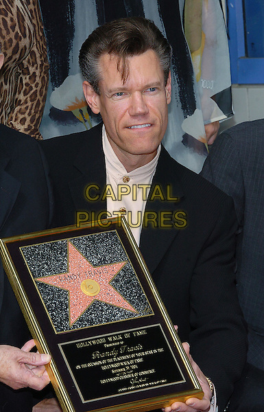 RANDY TRAVIS.is honored with Star on the Hollywood Walk of Fame, Hollywood, CA, USA, September 29, 2004..half length holding frame.Ref: ADM.www.capitalpictures.com.sales@capitalpictures.com.©JW/AdMedia/Capital Pictures .