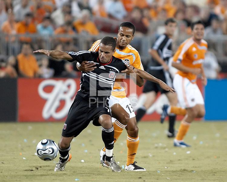 D.C. United midfielder Fred (7) attempts to break free from Houston Dynamo midfielder Ricardo Clark (13).  Houston Dynamo defeated D.C. United 1-0 at Robertson Stadium in Houston, TX on July 8, 2007.
