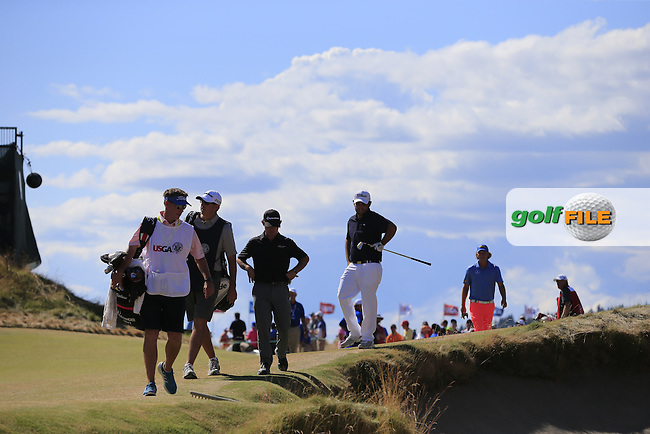 Alexander Levy (FRA) looks for his ball buried in a bunker at the 10th green during Friday's Round 2 of the 2015 U.S. Open 115th National Championship held at Chambers Bay, Seattle, Washington, USA. 6/20/2015.<br /> Picture: Golffile | Eoin Clarke<br /> <br /> <br /> <br /> <br /> All photo usage must carry mandatory copyright credit (&copy; Golffile | Eoin Clarke)