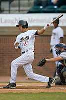 Jiovanni Mier #21 of the Greeneville Astros follows through on his swing versus the Danville Braves at Pioneer Park June 28, 2009 in Greeneville, Tennessee. (Photo by Brian Westerholt / Four Seam Images)