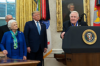 Former United States Attorney General Edwin Meese, right, makes remarks after US President Donald J. President Donald J. President Donald J. Trump, center, presented him the Presidential Medal of Freedom at the White House in Washington, DC, October 8, 2019. Meese served from 1985 to 1988 under US President Ronald Reagan.  At left is Meese's wife Ursula Meese. Credit: Chris Kleponis / Pool via CNP /MediaPunch