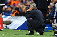 Jose Mourinho (Manager) of Chelsea crouches down as he looks on during the UEFA Champions League match between Chelsea and Maccabi Tel Aviv at Stamford Bridge, London, England on 16 September 2015. Photo by David Horn.