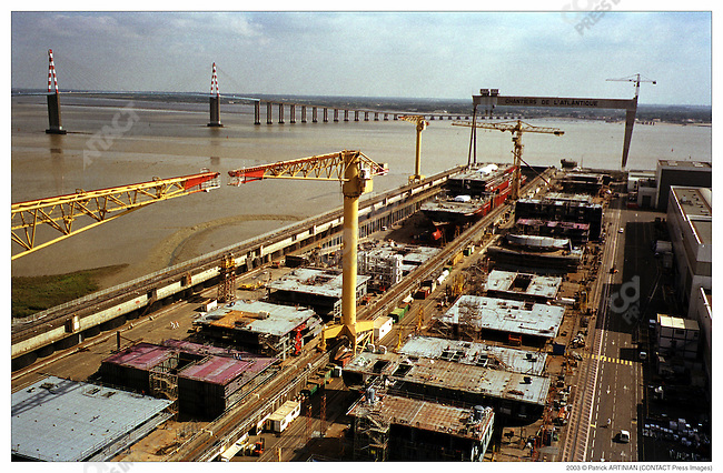 Construction of Queen Mary 2, Alstom Marine, Chantiers de l'Atlantique, Saint-Nazaire, France, September 2002. Saint Nazaire bridge in background