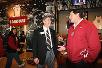 13 December 2007: Stanford Cardinal athletic director Bob Bowlsby (left) and men's volleyball head coach John Kosty (right) attend a pre-game social at Center Court before Stanford's 23-30, 30-20, 30-25, 20-30, 16-14 win against the USC Trojans in the 2007 NCAA Division I Women's Volleyball Final Four semifinal match at ARCO Arena in Sacramento, CA.