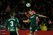 13th April 2018, Estadi Montilivi, Girona, Spain; La Liga football, Girona versus Real Betis; Aissa Mandi of Betis and Anthony Lozano of Girona challenge for an aerial ball