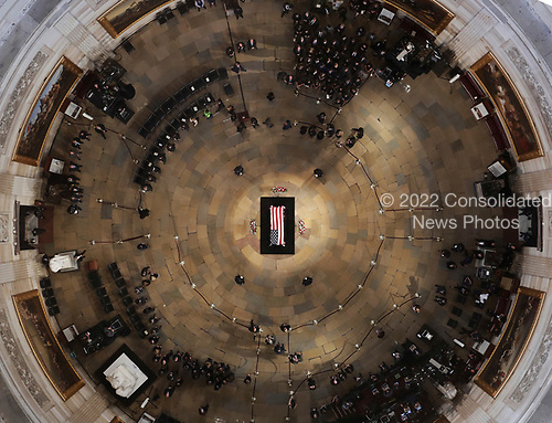 The late U.S. Sen. John McCain, R-Ariz., lies in state in the U.S. Capitol Rotunda Friday, Aug. 31, 2018, in Washington. (Pool photo by Morry Gash via AP)