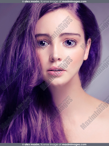 Cute young woman face with big sad eyes and long purple hair retouched in Japanese anime style