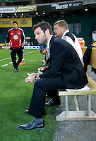 D.C. United head coach Ben Olsen sits on the sideline before the game at RFK Stadium in Washington, DC.  D.C. United tied the Colorado Rapids, 1-1.