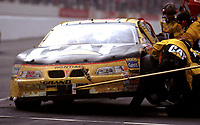 NASCAR driver Ward Burton makes a pit stop enroute to victory in the Mall.Com 400 at Darlington , SC Sunday, March 19, 2000.(Photo by Brian Cleary)