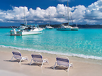 Beach and boats with chairs. Jost Van Dyke. British Virgin Islands