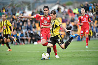 Nathan Burns ( Phoenix ) and Dylan McGowan ( Adelaide ) in action during the A League - Wellington Phoenix v Adelaide United at Hutt Recreational Ground, Lower Hutt, New Zealand on Saturday 7 March 2015. <br /> Photo by Masanori Udagawa. <br /> www.photowellington.photoshelter.com.