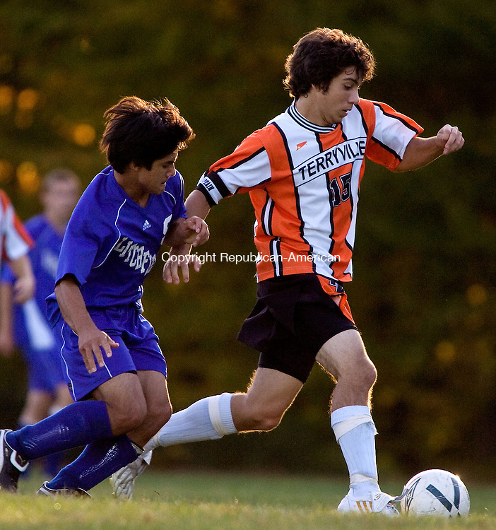 TERRYVILLE, CT - 07 OCTOBER 2008 -100708JT07--<br /> Litchfield's Brandon O'Halloron, left, catches up to Terryville's Ronny Bilodeau during Tuesday's game in Terryville. The game was tied, 3-3.<br /> Josalee Thrift / Republican-American