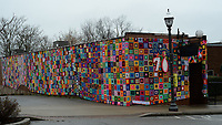 Crochet artwork covers Maxine's Tap Room Saturday, March 14, 2020, on Block Avenue in Fayetteville. Crochet artist Gina Gallina yarn-bombed Maxine's in honor of its 70th anniversary. Visit nwaonline.com/200322Daily/ for today's photo gallery.<br /> (NWA Democrat-Gazette/Andy Shupe)