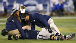 Nevada Head Coach Brian Polian, rear, and team medical staff tend to injured linebacker Jeremy Macauley in an NCAA college football game against San Jose State, in Reno, Nev., on Saturday, Nov. 16, 2013. (AP Photo/Cathleen Allison)