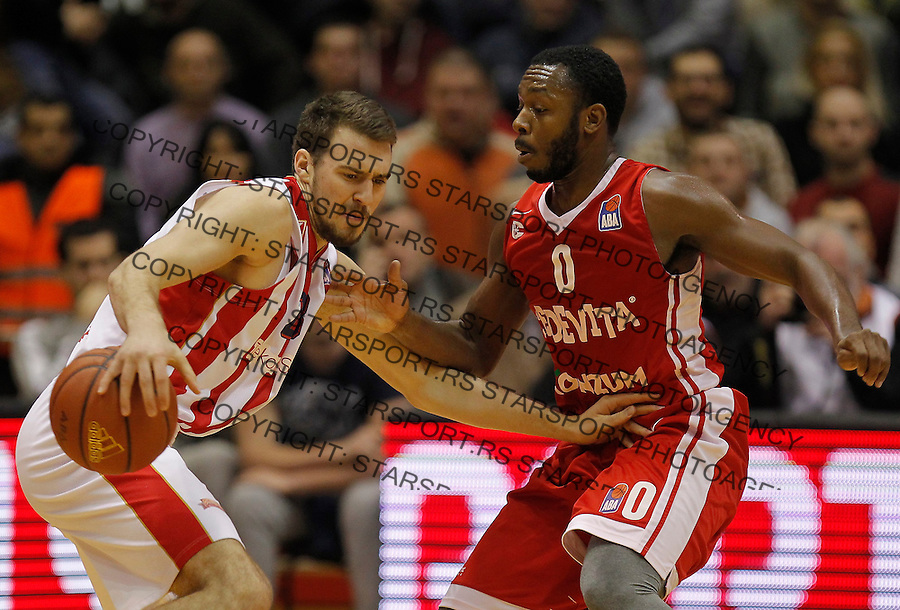 Kosarka ABA League season 2015-2016<br /> Crvena Zvezda v Cedevita<br /> Marko Guduric (L) and Jacob Pullen<br /> Beograd, 04.01.2015.<br /> foto: Srdjan Stevanovic/Starsportphoto&copy;