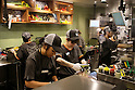Staff of the new Taco Bell branch start to work during the pre-opening event for the restaurant's first Japanese store located in Tokyo's Shibuya district, on April 20, 2015, Japan. The store includes Japan specific dishes like shrimp and avocado burrito and taco rice on its menu. It will open to the public on April 21st. The American Tex-Mex fast food restaurant has signed a franchise agreement with Asrapport Dining Co., Ltd. to operate Taco Bell branches in Japan. (Photo by Rodrigo Reyes Marin/AFLO)