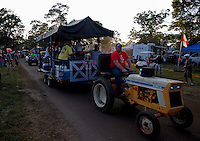 Aug. 17, 2013; Brainerd, MN, USA: NHRA fans drink on a mobile bar towed by a tractor in the Zoo campground outside of the pit area following qualifying for the Lucas Oil Nationals at Brainerd International Raceway. Mandatory Credit: Mark J. Rebilas-