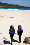 Hikers on the Cape to Cape track at Smith's Beach, Yallingup.  Leeuwin-Naturaliste National Park, Western Australia, AUSTRALIA.