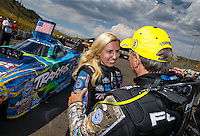Jul 24, 2016; Morrison, CO, USA; NHRA funny car driver John Force (right) consoles daughter Courtney Force after defeating her in the final round to win the Mile High Nationals at Bandimere Speedway. Mandatory Credit: Mark J. Rebilas-USA TODAY Sports
