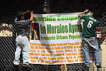 Mexican demostrators hang up a banner on a wire fence as they attend the meeting to support Bolivian president Evo Morales in Coyoacan, a Mexico City's dicstrict, Februray 21, 2010. Thousands of people are expected to gather around Evo Morales. Photo by Heriberto Rodriguez