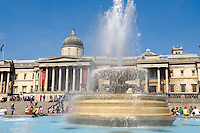 Fountains in Trafalgar Square London, with National Gallery behind