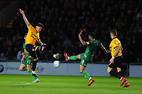 Regan Poole of Newport County vies for possession with Alex MacDonald of Mansfield Town during the Sky Bet League Two Play-off Semi Final: First Leg match between Newport County and Mansfield Town at Rodney Parade in Newport, Wales, UK.  Thursday 09 May 2019