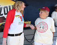 "NWA Democrat-Gazette/J.T. WAMPLER Gina Davis visits with Dolly Konwinski Sunday May 7, 2017 during the ""A League of Their Own"" reunion softball game at Arvest Ballpark in Springdale. Konwinski played professional baseball between 1948 and 1952 for the Battle Creek Belles, Chicago Colleens, Grand Rapids Chicks and the Springfield Sallies. The event concluded the Bentonville Film Festival."