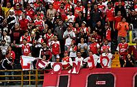BOGOTÁ - COLOMBIA, 20-01-2019: Hinchas de Independiente Santa Fe, animan a su equipo, durante partido entre Independiente Santa Fe y Millonarios, por el Torneo Fox Sports 2019, jugado en el estadio Nemesio Camacho El Campin de la ciudad de Bogotá. / Fans Independiente Santa Fe, cheer for their team during a match between Independiente Santa Fe and Millonarios, for the Fox Sports Tournament 2019, played at the Nemesio Camacho El Campin stadium in the city of Bogota. Photo: VizzorImage / Luis Ramírez / Staff.