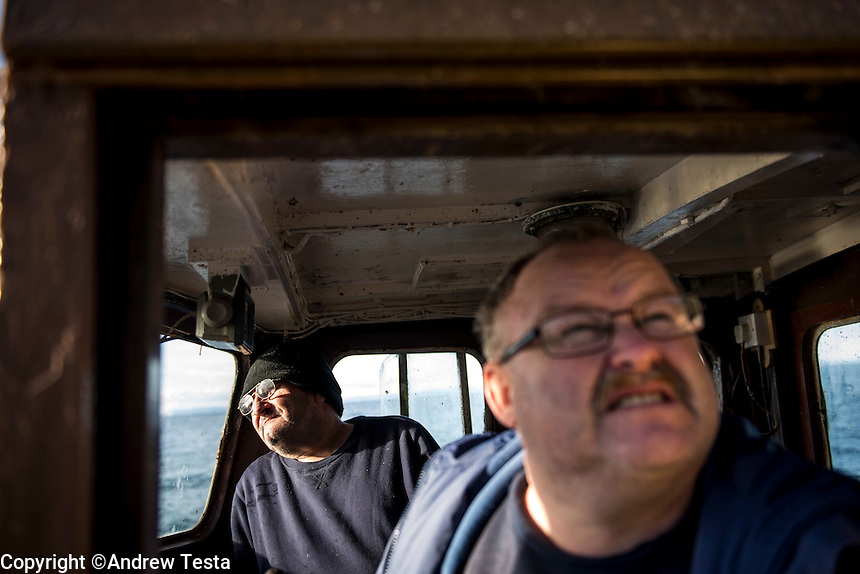 Scotland. Ailsa Craig . 10th November 2013<br /> Mark McCrindle (right) and Jim McWhirter on their boat 'Glorious'.<br /> &copy;Andrew Testa for the New York Times