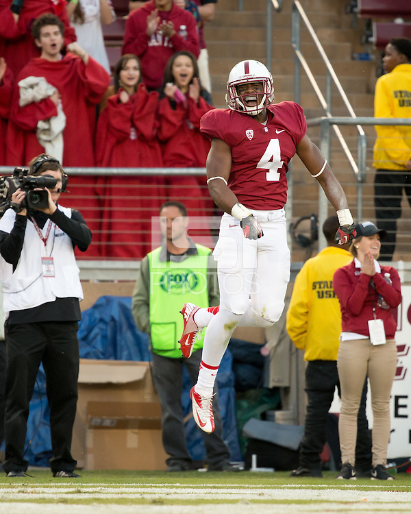 Stanford, CA -- November 23, 2013:  Stanford's Francis Owusu celebrates after scoring a touchdown during a game against Cal at Stanford Stadium. Stanford defeated Cal 63-13.