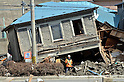 April 1st, 2011, Miyako, Japan - The upstairs of a two-story townhouse sits precariously in Miyako City, Iwate Prefecture, on April 1, 2011, three weeks after the city was devastated by a magnitude 9.0 earthquake and ensuing tsunami. (Natsuki Sakai/AFLO) [3615] -mis-...