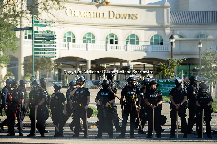 """September 5, 2020:  Police stand guard outside of Churchill Downs  the 146th Kentucky Derby. With the Kentucky Derby being the biggest sports event for the State of Kentucky, protestors have chosen the  event as a focal point for their calls for justice in the death of Breonna Taylor. Multiple groups from around the country have converged on Louisville to protest during the """"Run for the Roses"""" at Churchill Downs in Louisville. Michael Clubb/Eclipse Sportswire/CSM"""