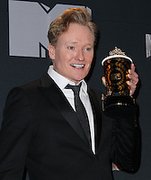 LOS ANGELES, CA, USA - APRIL 13: Conan O'Brien in the press room at the 2014 MTV Movie Awards held at Nokia Theatre L.A. Live on April 13, 2014 in Los Angeles, California, United States. (Photo by Xavier Collin/Celebrity Monitor)