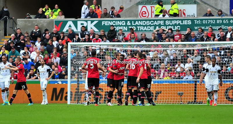 Manchester united celebrate their second goal scored by Danny Welbeck.<br /> Saturday 17 August 2013<br /> Pictured: <br /> Re: Barclays Premier League Swansea City v Manchester United at the Liberty Stadium, Swansea, Wales