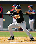 14 March 2006: Eric Reed, outfielder for the Florida Marlins, lays down a bunt during a Spring Training game against the Washington Nationals. The Marlins defeated the Nationals 2-1 at Space Coast Stadium, in Viera, Florida...Mandatory Photo Credit: Ed Wolfstein..