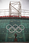 Uruguay 2 United Arab Emirates 1, Great Britain 1 Senegal 1, 26/07/2012. Old Trafford, Olympic Games. The Olympic rings adorn the exterior of Manchester United's Old Trafford stadium above a statue to Sit Matt Busby prior to the Men's Olympic Football tournament matches at the venue. The double header of matches resulted in Uruguay defeating the United Arab Emirates by 2-1 while Great Britain and Senegal drew 1-1. Over 72,000 spectators attended the two Group A matches. Photo by Colin McPherson.
