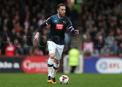 April 14th 2017,  Brent, London, England; Skybet Championship football, Brentford versus Derby County; Richard Keogh of Derby County brings the ball forward