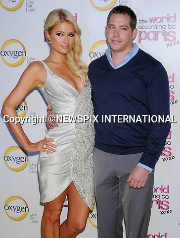 "Paris Hilton and Cy Waits.arrives at ""The World According to Paris"" Premiere Party at the Tropicana Bar at the Hollywood Roosevelt Hotel on May 17, 2011 in Hollywood, California..Mandatory Photo Credit: ©Crosby/Newspix International..**ALL FEES PAYABLE TO: ""NEWSPIX INTERNATIONAL""**..PHOTO CREDIT MANDATORY!!: NEWSPIX INTERNATIONAL(Failure to credit will incur a surcharge of 100% of reproduction fees)..IMMEDIATE CONFIRMATION OF USAGE REQUIRED:.Newspix International, 31 Chinnery Hill, Bishop's Stortford, ENGLAND CM23 3PS.Tel:+441279 324672  ; Fax: +441279656877.Mobile:  0777568 1153.e-mail: info@newspixinternational.co.uk"