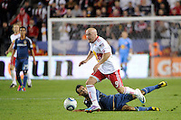 Luke Rodgers (9) of the New York Red Bulls gets past a fallen Juninho (19) of the Los Angeles Galaxy. The New York Red Bulls defeated the Los Angeles Galaxy 2-0 during a Major League Soccer (MLS) match at Red Bull Arena in Harrison, NJ, on October 4, 2011.