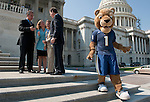From left, Florida Reps. Mario Diaz-Balart, Debbie Wasserman Schultz, Ileana Ros-Lehtinen and Lincoln Diaz-Balart talk on the House steps after posing for photos with Roary, the mascot for Florida International University, on Sept. 23, 2010. FIU staff were in Washington to lobby Congress, and to attend their football game against the University of Maryland.