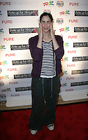 SARAH SILVERMAN.The Ante Up for Africa Celebrity Poker Tournament at the Rio Resort Hotel and Casino, Las Vegas, Nevada, USA..July 2nd, 2009.full length grey gray tracksuit bottoms purple black white striped stripes hands eyes closed .CAP/ADM/MJT.© MJT/AdMedia/Capital Pictures