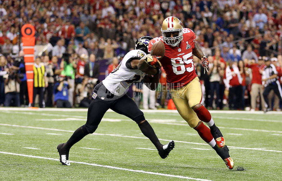 Feb 3, 2013; New Orleans, LA, USA; San Francisco 49ers tight end Vernon Davis (85) is tackled by Baltimore Ravens free safety Ed Reed (20) in the first quarter in Super Bowl XLVII at the Mercedes-Benz Superdome. Mandatory Credit: Mark J. Rebilas-