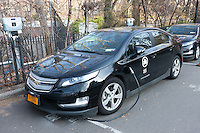 A Chevy Volt plug-in hybrid electric vehicle, used by the New York City Parks and Recreation department, receives a charge at a charging station in Central Park.