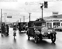 1924 Rolls Royce convertible owned and driven by Mr A J Thompson of Burnaby B C entering rain soaked streets in Kamloops British Columbia Canada