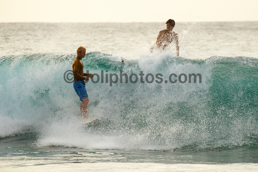 HONOLULU, North Shore, Off The Wall - (Sunday, November 18, 2012) Nat Young (USA) and  Gabriel Medina (BRA). --2'-3 surf at Off The Wall today.  Photo: joliphotos.com