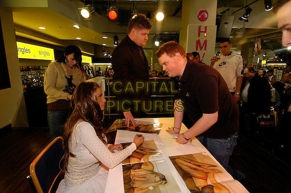 JORDAN.at HMV Oxford Street signing copies of her calendar.London England 2 December 2005.Ref:HT.katie price pryce .www.capitalpictures.com.sales@capitalpictures.com.©Capital Pictures