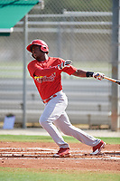 GCL Cardinals third baseman Elehuris Montero (23) follows through on a swing during a game against the GCL Mets on July 23, 2017 at Roger Dean Stadium Complex in Jupiter, Florida.  GCL Cardinals defeated the GCL Mets 5-3.  (Mike Janes/Four Seam Images)