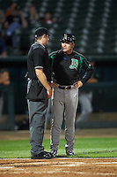 Dayton Dragons manager Dick Schofield (22) talks with umpire Ryan Wilhelms during a game against the Peoria Chiefs on May 6, 2016 at Dozer Park in Peoria, Illinois.  Peoria defeated Dayton 5-0.  (Mike Janes/Four Seam Images)