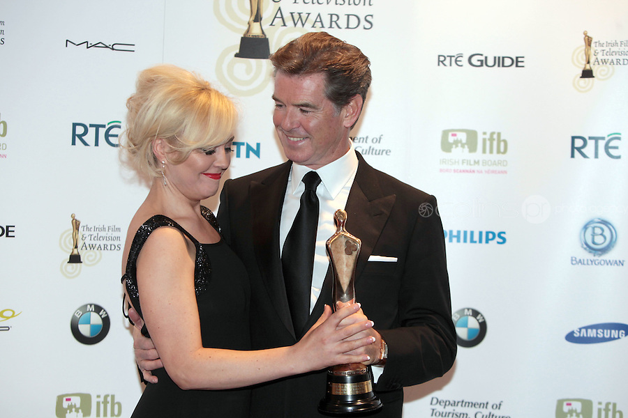 12/2/11 Angelina Ball with Pierce Brosnan, Best Actor in a supporting role for The Ghost, at the 8th Irish Film and Television Awards at the Convention centre in Dublin. Picture:Arthur Carron/Collins