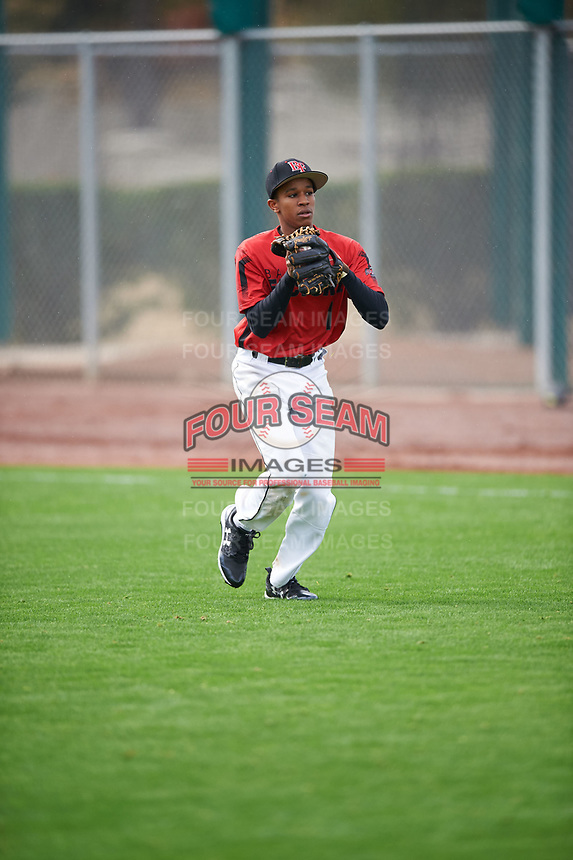 Christophe Senghor (1) of McIntosh High School in Peachtree City, Georgia during the Under Armour All-American Pre-Season Tournament presented by Baseball Factory on January 14, 2017 at Sloan Park in Mesa, Arizona.  (Mike Janes/MJP/Four Seam Images)